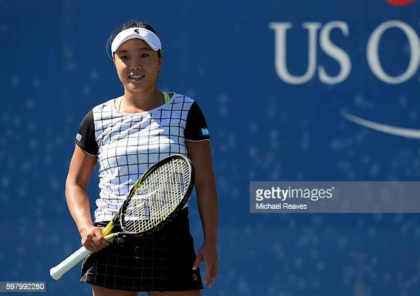 Kurumi Nara of Japan reacts against Stefanie Voegele of Switzerland during her first round Women's Singles match on Day Two of the 2016 US Open at...