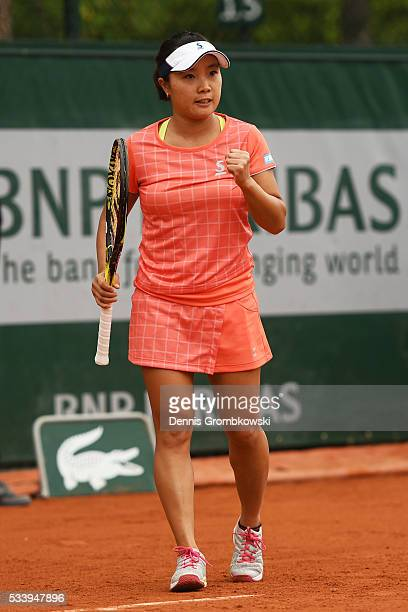 Kurumi Nara of Japan reacts during the Ladies Singles first round match against Denisa Allertova of Czech Republic on day three of the 2016 French...