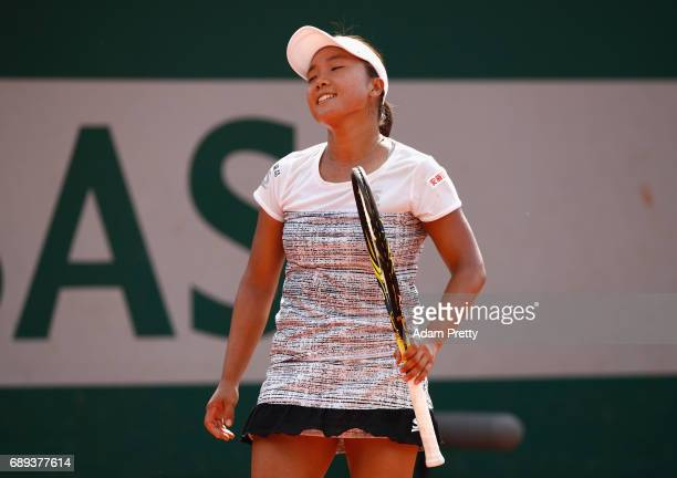 Kurumi Nara of Japan reacts during the ladies singles first round match against Amanda Anisimova of The United States on day one of the 2017 French...