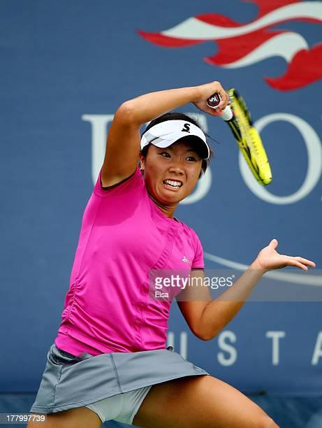 Kurumi Nara of Japan returns a shot against Alexandra Cadantu of Romania during their first round women's singles match on Day One of the 2013 US...