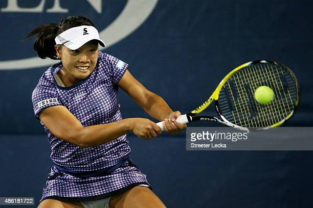Kurumi Nara of Japan returns a shot against Alize Cornet of France during their Women's Singles First Round match on Day Two of the 2015 US Open at...