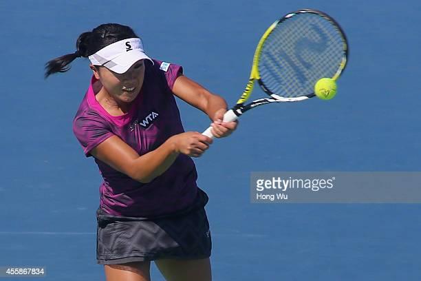 Kurumi Nara of Japan returns a shot during her match against Svetlana Kuznetsova of Russia during day one of the 2014 Dongfeng Motor Wuhan Open at...