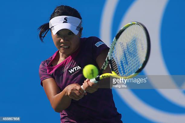 Kurumi Nara of Japan returns a shot during her match against Svetlana Kuznetsova of Russia during day one of the 2014 Dongfeng Motor Wuhan Open at...