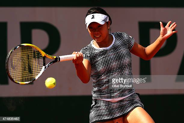 Kurumi Nara of Japan returns a shot during her women's singles match against Lucie Safarova of Czech Republic during day four of the 2015 French Open...
