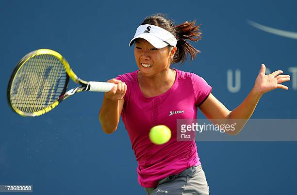 Kurumi Nara of Japan returns a shot during her women's singles third round match against Jelena Jankovic of Serbia on Day Five of the 2013 US Open at...