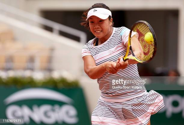 Kurumi Nara of Japan returns a shot in her ladies singles second round match against Serena Williams of the United States during Day five of the 2019...
