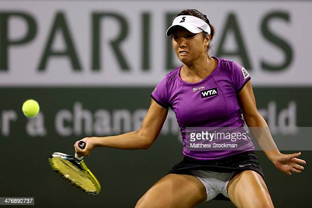 Kurumi Nara of Japan returns a shot to Allie Kiick during the BNP Paribas Open at the Indian Wells Tennis Garden on March 5 2014 in Indian Wells...