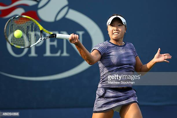 Kurumi Nara of Japan returns a shot to Shelby Rogers of the United States during their Women's Singles Second Round match on Day Four of the 2015 US...