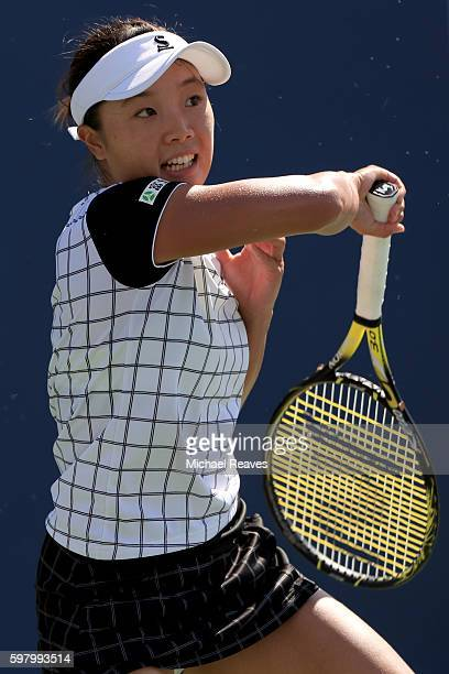Kurumi Nara of Japan returns a shot to Stefanie Voegele of Switzerland during her first round Women's Singles match on Day Two of the 2016 US Open at...