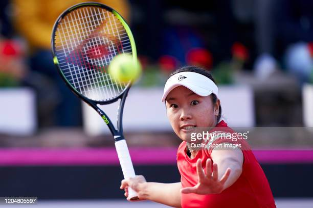Kurumi Nara of Japan returns the ball during her match against Carla Suarez of Spain during the 2020 Fed Cup Qualifier between Spain and Japan at...