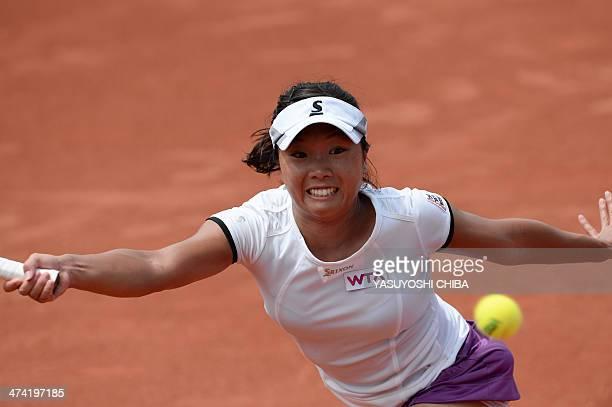Kurumi Nara of Japan returns the ball to Nastassja Burnett of Italy during their 2014 Rio Open women's semifinal singles tennis match in Rio de...