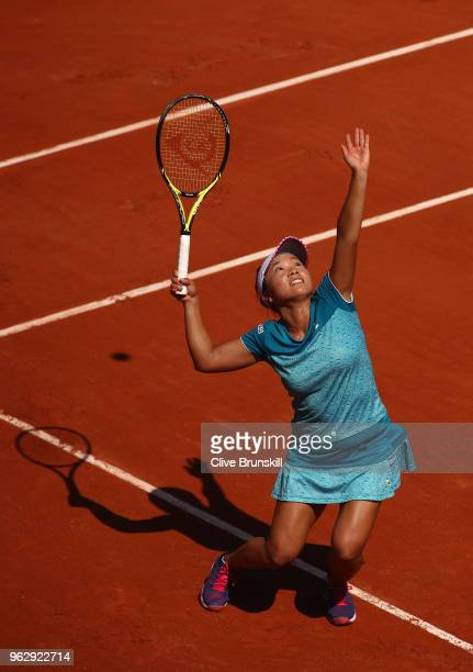 Kurumi Nara of Japan serves against Barbora Strycova of the Czech Republic in their first round womens singles match on day one of the French Open at...