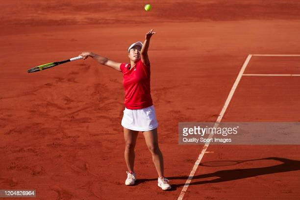 Kurumi Nara of Japan serves during her match against Carla Suarez of Spain during the 2020 Fed Cup Qualifier between Spain and Japan at Centro de...