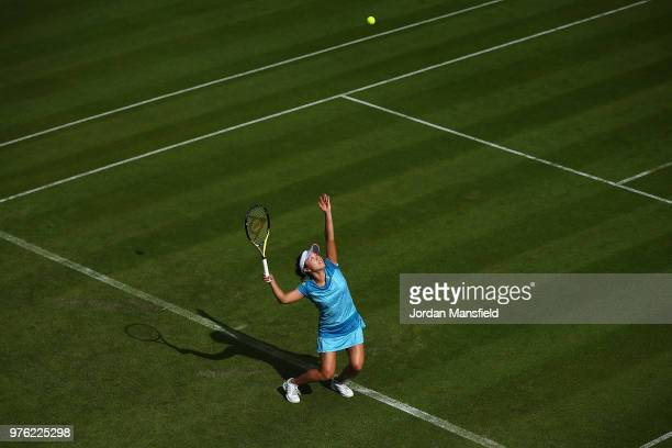 Kurumi Nara of Japan serves during her qualifying match against Camila Giorgi of Italy during day one of the Nature Valley Classic at Edgbaston...
