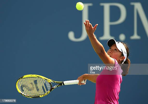 Kurumi Nara of Japan serves during her women's singles third round match against Jelena Jankovic of Serbia on Day Five of the 2013 US Open at USTA...