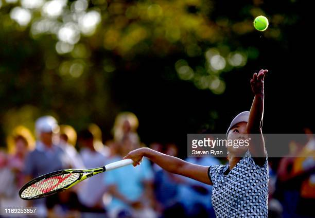 Kurumi Nara of Japan serves the ball during her women's singles first round match against Timea Babos of Hungary on Day Two of the 2019 US Open...
