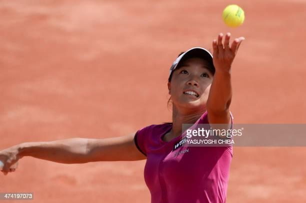 Kurumi Nara of Japan serves the ball to Nastassja Burnett of Italy during their 2014 Rio Open women's semifinal singles tennis match in Rio de...