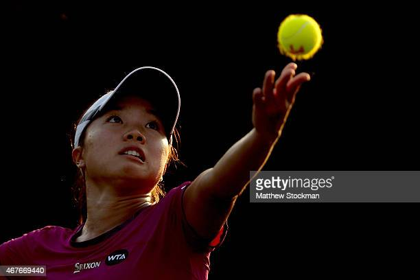 Kurumi Nara of Japan serves to Caroline Garcia of France during day 4 of the Miami Open Presented by Itau at Crandon Park Tennis Center on March 26...
