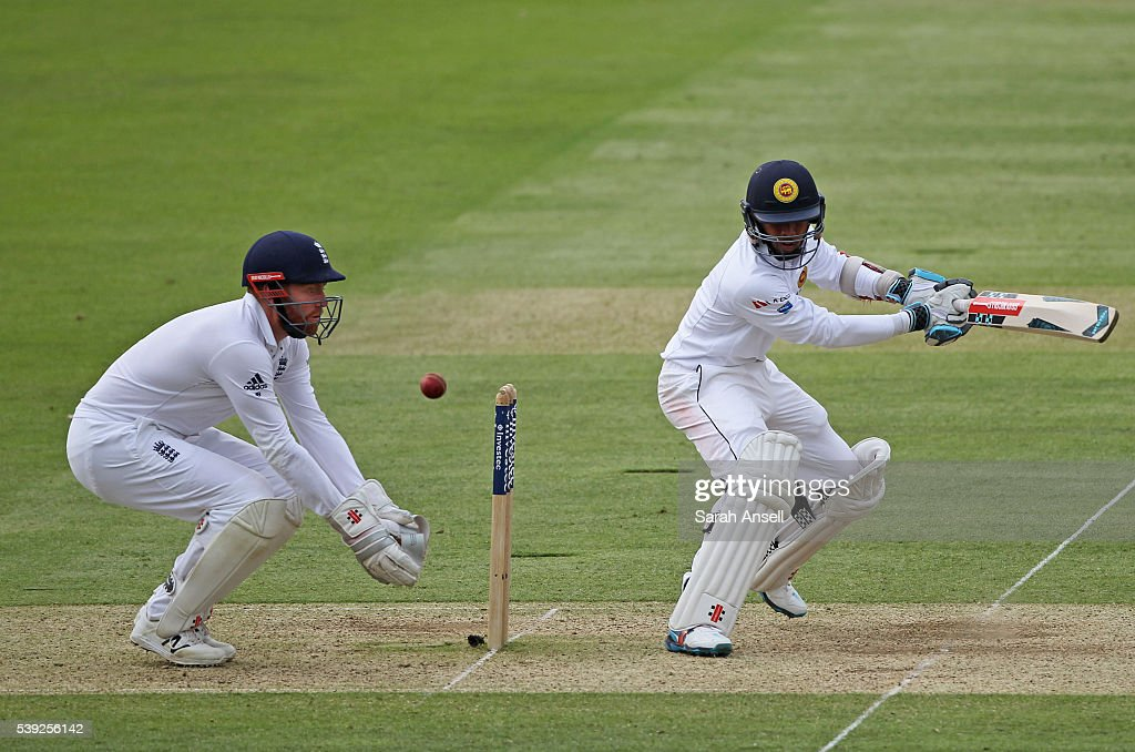 Kusal Mendis hits out as England wicket keeper Jonny Bairstow looks on during day two of the 3rd Investec Test match between England and Sri Lanka at Lord's Cricket Ground on June 10, 2016 in London, United Kingdom.