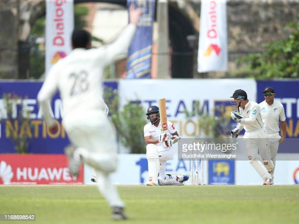Kusal Mendis of Sri Lanka after his dismissal as BradleyJohn Watling of New Zealand celebrates during day five of the First Test match between Sri...