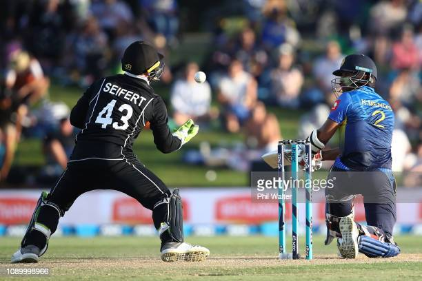 Kusal Mendis of Sri Lanka Ash Sodhi of the New Zealand Blackcaps caight behind by Tim Seifert of the New Zealand Blackcaps during game two in the One...