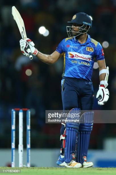 Kusal Mendis of Sri Lanka celebrates after reaching his half century during the Twenty20 International match between Sri Lanka and New Zealand at...