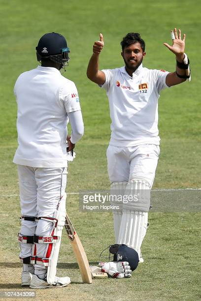 Kusal Mendis of Sri Lanka celebrates his 6th test century during day four of the First Test match in the series between New Zealand and Sri Lanka at...