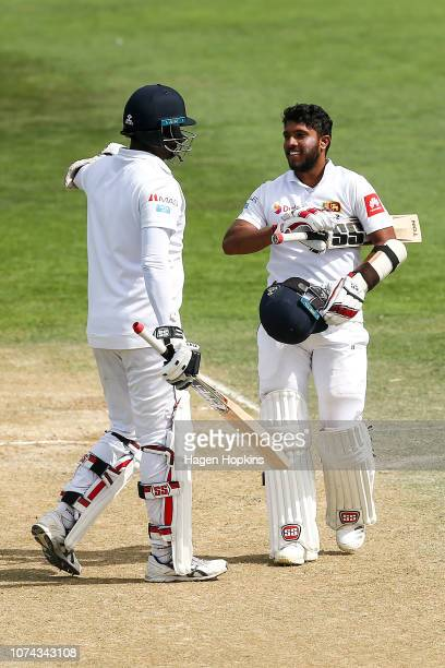 Kusal Mendis of Sri Lanka celebrates his 6th test century with Angelo Mathews during day four of the First Test match in the series between New...