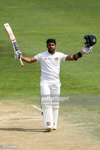 Kusal Mendis of Sri Lanka celebrates his century during day four of the First Test match in the series between New Zealand and Sri Lanka at Basin...
