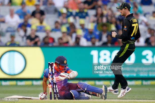 Kusal Mendis of Sri Lanka crashes into the stumps after diving to avoid a run out during game three of the Men's International Twenty20 match between...