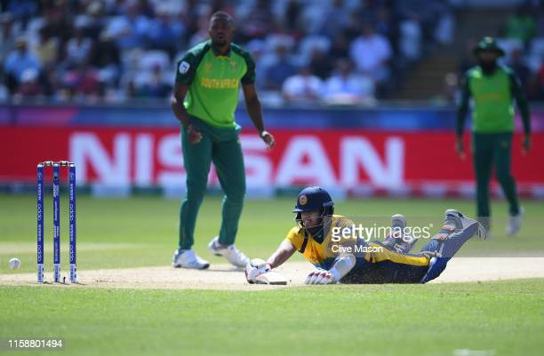 Kusal Mendis of Sri Lanka dives to avaoid a run out attempt during the Group Stage match of the ICC Cricket World Cup 2019 between Sri Lanka and...