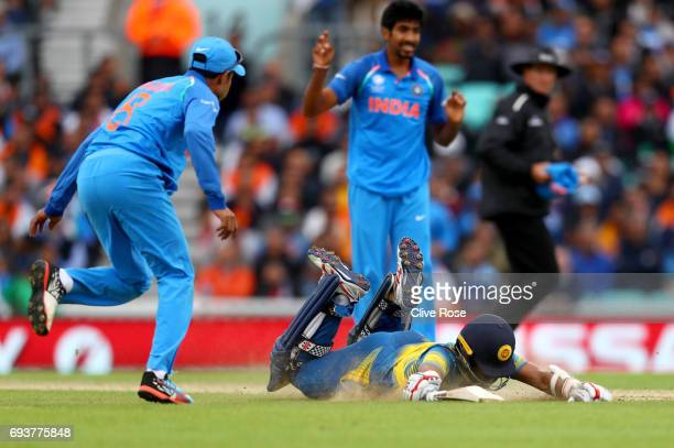 Kusal Mendis of Sri Lanka dives to make his ground during the ICC Champions trophy cricket match between India and Sri Lanka at The Oval in London on...