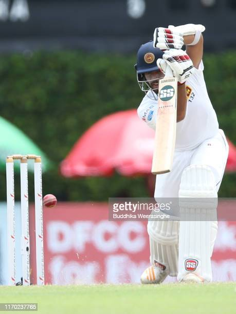 Kusal Mendis of Sri Lanka hits out during day five of the Second Test match between Sri Lanka and New Zealand at Paikiasothy Saravanamuttu Stadium on...