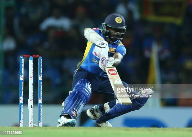 Kusal Mendis of Sri Lanka hits out during the Twenty20 International match between Sri Lanka and New Zealand at Pallekele Cricket Stadium on...