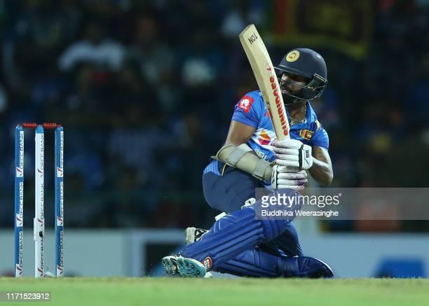 Kusal Mendis of Sri Lanka hits out during the Twenty20 International match between Sri Lanka and New Zealand at Pallekele Cricket Stadium on...