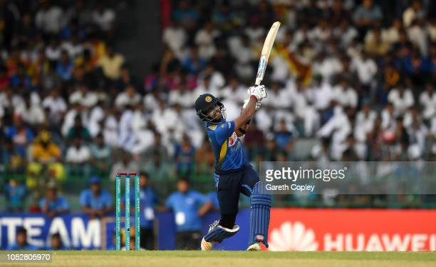 Kusal Mendis of Sri Lanka hits out for six runs during the 5th One Day International match between Sri Lanka and England at R Premadasa Stadium on...