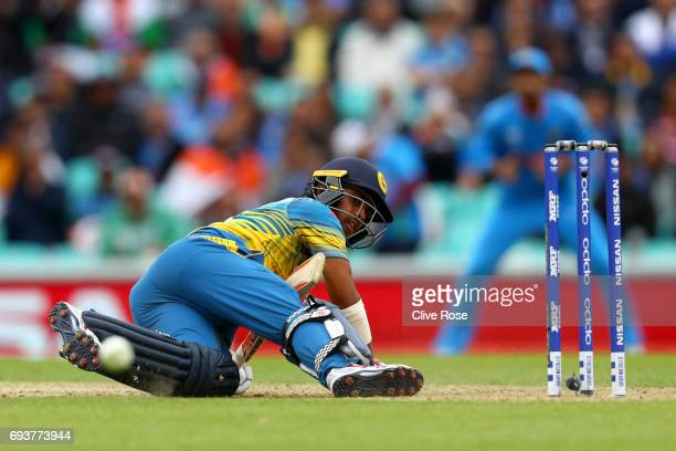 Kusal Mendis of Sri Lanka looks on after being put down by a yorker delivery during the ICC Champions trophy cricket match between India and Sri...