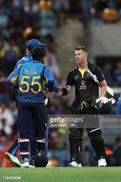 Kusal Mendis of Sri Lanka shakes hands with David Warner of Australia after Australia won during game two of the Men's International Twenty20 series...