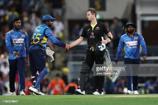 Kusal Mendis of Sri Lanka shakes hands with Steve Smith of Australia after Australia won during game two of the Men's International Twenty20 series...