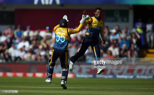 Kusal Perera and Dhananjaya de Silva celebrate the wicket of Chris Woakes during the ICC Cricket World Cup 2019 match between England and Sri Lanka...