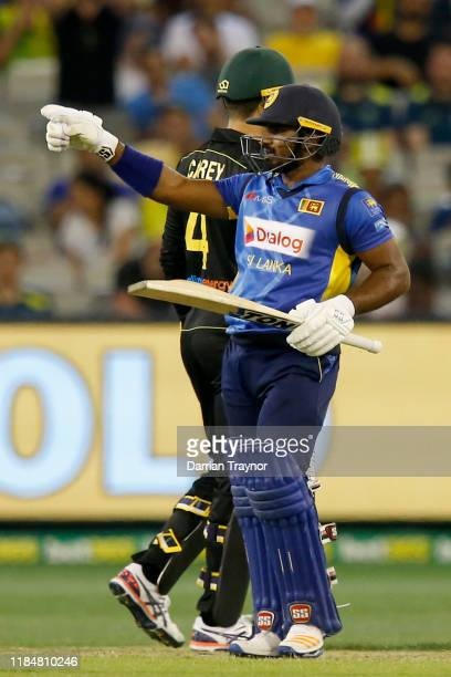 Kusal Perera of Sri Lanka acknowledges his team mates after scoring 50 runs during game three of the Men's International Twenty20 match between...