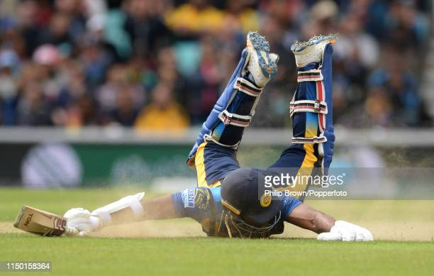 Kusal Perera of Sri Lanka dives into his ground during the ICC Cricket World Cup Group Match between Sri Lanka and Australia at the Kia Oval on June...