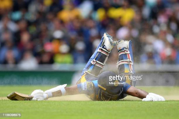 Kusal Perera of Sri Lanka dives to make his ground during the Group Stage match of the ICC Cricket World Cup 2019 between Sri Lanka and Australia at...