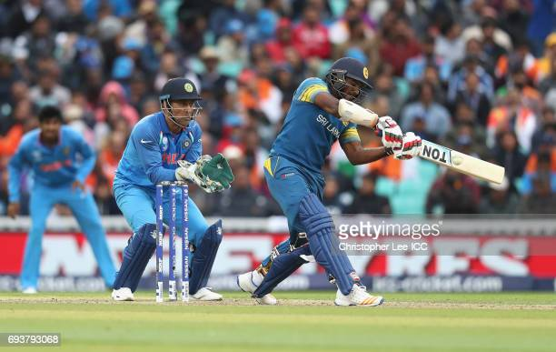 Kusal Perera of Sri Lanka in action with MS Dhoni of India during the ICC Champions Trophy Group B match between India and Sri Lanka at The Kia Oval...
