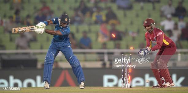 Kusal Perera of Sri Lanka is bowled by Krishmar Santokie of the West Indies during the ICC World Twenty20 Bangladesh 2014 semi final between Sri...