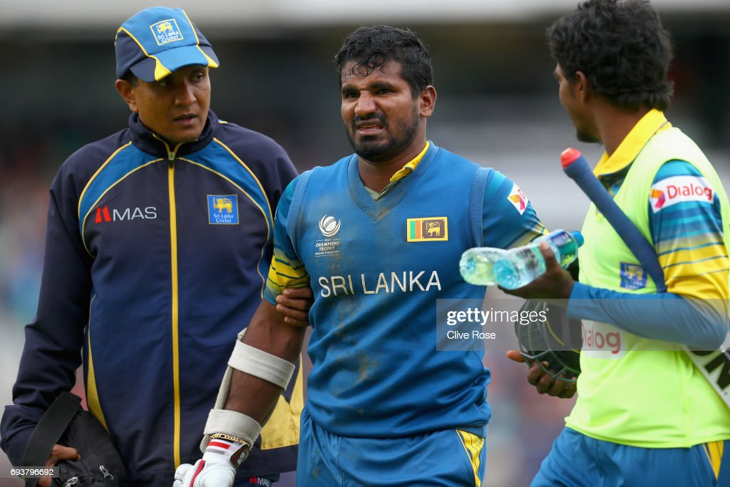 Kusal Perera of Sri Lanka leaves the field after injuring himself during the ICC Champions trophy cricket match between India and Sri Lanka at The Oval in London on June 8, 2017