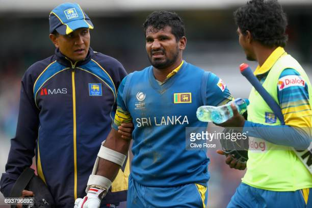 Kusal Perera of Sri Lanka leaves the field after injuring himself during the ICC Champions trophy cricket match between India and Sri Lanka at The...