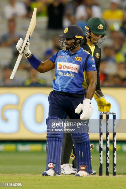 Kusal Perera of Sri Lanka raises his bat after scoring 50 runs during game three of the Men's International Twenty20 match between Australia and Sri...
