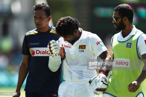 Kusal Perera of Sri Lanka retires hurt after being hit by a ball from Jhye Richardson of Australia during day three of the Second Test match between...