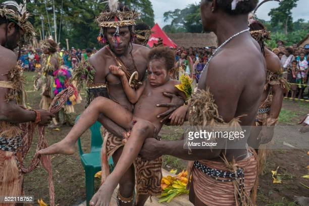 kusare worriors sing-sing group during a circumcision ceremony - circumcision stock pictures, royalty-free photos & images